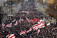 Opposition supporters parade through the streets during a rally to protest against the Belarus presidential election results in Minsk on October 18, 2020. (Photo by - / AFP)
