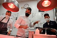 Spanish chef Paco Roncero (C) works in the kitchen with his team in his restaurant at the Casino of Madrid in the Spanish capital on November 13, 2020. - Spain has been one of the countries worst affected by the coronavirus pandemic and while its tourism-dependent economy generally did better in the third quarter, a resurgence in cases has led to new restrictions which many fear will once again hit business hard. (Photo by Gabriel BOUYS / AFP)