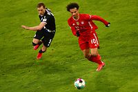 Bayern Munich's German midfielder Leroy Sane (R) and Bielefeld's Danish defender Jacob Barrett Laursen vie for the ball during the German first division Bundesliga football match FC Bayern Munich v DSC Armenia Bielefeld in Munich, southern Germany on February 15, 2021. (Photo by ADAM PRETTY / POOL / AFP) / DFL REGULATIONS PROHIBIT ANY USE OF PHOTOGRAPHS AS IMAGE SEQUENCES AND/OR QUASI-VIDEO