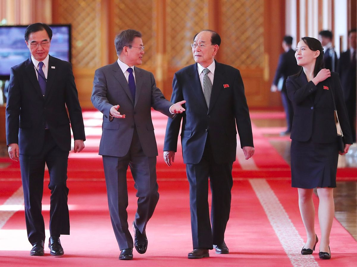 South Korea's President Moon Jae-in (2nd L) walks with North Korean leader Kim Jong Un's sister Kim Yo Jong (R) and North Korea's ceremonial head of state Kim Yong Nam (2nd R) as they move for a luncheon at the presidential Blue House in Seoul on February 10, 2018. (AFP)