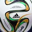 A replica of a Adidas Brazuca soccer ball, the official ball used during the 2014 World Cup final match between Germany and Argentina, is displayed at the Maracana stadium in Rio de Janeiro in this July 12,  2014 file photo. Adidas, the world's second-biggest sportswear firm, cut its margin targets for 2014 on August 7, 2014, a week after it issued a profit warning, blaming poor performance at its golf business and volatile emerging market currencies.  REUTERS/Dylan Martinez/Files (BRAZILSOCCER CUP - Tags: SPORT BUSINESS)