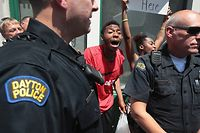 DAYTON, OHIO - AUGUST 07: Police separate pro and anti-Trump demonstrators in the Oregon District, where a mass shooting early Sunday morning left nine dead and 27 wounded, on August 07, 2019 in Dayton, Ohio. President Donald Trump visited the city today to offer his support to the community but did not go into the Oregon District where the shooting occurred. The shooting happened less than 24 hours after a gunman in Texas opened fire at a shopping mall in El Paso killing 22 people. Trump is scheduled to visit El Paso later today.   Scott Olson/Getty Images/AFP == FOR NEWSPAPERS, INTERNET, TELCOS & TELEVISION USE ONLY ==