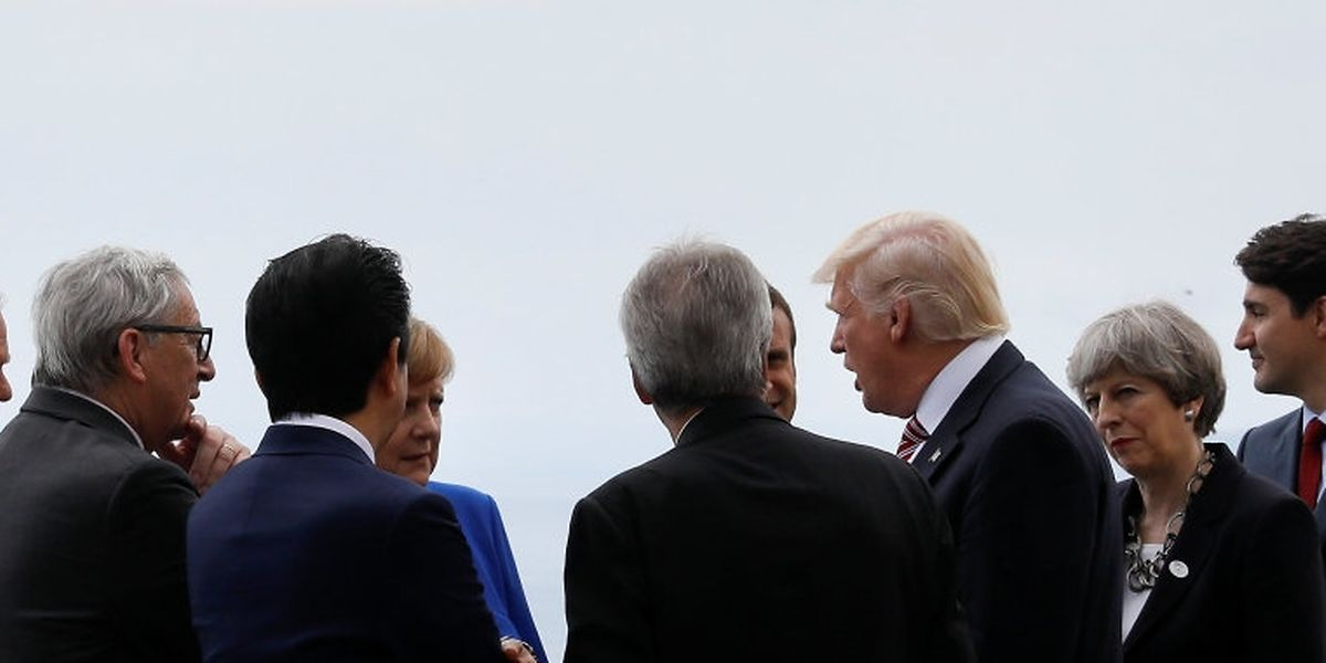 From L-R, European Council President Donald Tusk, European Commission President Jean-Claude Juncker, Japanese Prime Minister Shinzo Abe, German Chancellor Angela Merkel, Italian Prime Minister Paolo Gentiloni, U.S. President Donald Trump, French President Emmanuel Macron, Canadian Prime Minister Justin Trudeau and Britain's Prime Minister Theresa May gather as they attend the G7 Summit in Taormina, Sicily, Italy, May 26, 2017. REUTERS/Jonathan Ernst