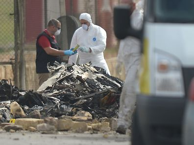 Forensics work on the site of a small plane crash at Malta International Airport,  on October 24, 2016. Five French nationals died when a small plane crashed shortly after take off from Malta's international airport, the island's government said. The plane had been chartered by French customs and had been involved in the surveillance of people and drugs trafficking off Malta, the government said in a statement.