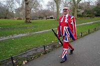 "TOPSHOT - A man in a Union Jack suit walks in Green park, London on December 13, 2019. - Conservative Prime Minister Boris Johnson today hailed a political ""earthquake"" in Britain after a thumping election victory which clears the way for the country to finally leave the EU next month after years of paralysing deadlock. (Photo by Niklas HALLE'N / AFP)"