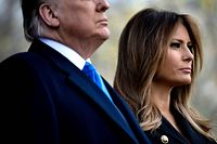 """(FILES) In this file photo taken on November 11, 2019, US President Donald Trump and US First Lady Melania Trump listen to Taps during a Veterans Day event at Madison Square Park in New York. - Melania Trump on December 4, 2019, publicly rebuked Constitutional law professor Pamela Karlan,who used her 13-year-old son's name to make a point during an impeachment hearing against the president. Karlan invoked Barron Trump to demonstrate how the Constitution imposes distinctions between a monarch's power and that of a president. """"The constitution says there can be no titles of nobility,"""" Karlan told lawmakers, """"So while the president can name his son 'Barron', he can't make him a baron."""" The pun led to chuckles in the congressional hearing room, but Melania Trump made clear it was no laughing matter. (Photo by Brendan Smialowski / AFP)"""