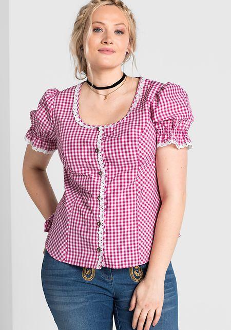 Dirndl muss nicht sein: Auch eine traditionell geschnittene Karobluse zur Jeans ergibt ein modernes Wiesn-Outfit.