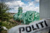(FILES) This file photo taken on April 25, 2018 shows the homemade submarine UC3 Nautilus as it is covered with green tarpaulin in Nordhavn, a harbour area in Copenhagen, Denmark. - Peter Madsen, who was sentenced to life in prison for the murder of Swedish journalist Kim Wall aboard his home-made submarine, admitted to the crime for the first time in a documentary broadcast Wednesday, September 9, 2020. (Photo by Mads Claus Rasmussen / Scanpix Denmark / AFP) / - Denmark OUT