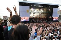 A picture taken on July 15, 2011 shows spectators during the 27th edition of the Francofolies de La Rochelle music festival in La Rochelle, western France. AFP PHOTO / XAVIER LEOTY