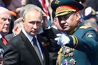 """This handout picture provided by Host photo agency shows Russian President Vladimir Putin and Defence Minister Sergei Shoigu during a military parade, which marks the 75th anniversary of the Soviet victory over Nazi Germany in World War Two, in Moscow on June 24, 2020. - The parade, usually held on May 9, was postponed this year because of the coronavirus pandemic. (Photo by - / Host photo agency / AFP) / RESTRICTED TO EDITORIAL USE - MANDATORY CREDIT """"AFP PHOTO / Host photo agency / -"""" - NO MARKETING NO ADVERTISING CAMPAIGNS - DISTRIBUTED AS A SERVICE TO CLIENTS --- NO ARCHIVE ---"""