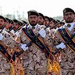 Members of Iran's Revolutionary Guards Corps (IRGC) march during the annual military parade marking the anniversary of the outbreak of the devastating 1980-1988 war with Saddam Hussein's Iraq, in the capital Tehran on September 22, 2018. - In Iran's southwestern city of Ahvaz during commemoration of the same event, dozens of people were killed with dozens others wounded in an attack targeting another army parade, state media reported on September 22. (Photo by STR / AFP)