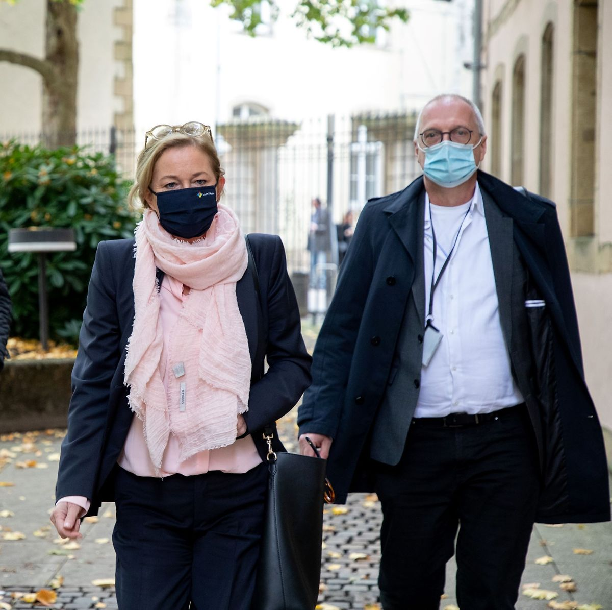 Luxembourg Health Minister Paulette Lenert and national Health Director Jean Claude Schmit arrive for a press briefing on Wednesday about the coronavirus pandemic PHOTO: Guy Jallay