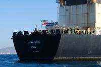 TOPSHOT - An Iranian flag flutters on board the Adrian Darya oil tanker, formerly known as Grace 1, off the coast of Gibraltar on August 18, 2019. - Gibraltar rejected a US demand to seize the Iranian oil tanker at the centre of a diplomatic dispute as it prepared to leave the British overseas territory after weeks of detention. (Photo by Johnny BUGEJA / AFP)