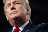 """(FILES) In this file photo taken on January 09, 2020 US President Donald Trump speaks during a """"Keep America Great"""" campaign rally at Huntington Center in Toledo, Ohio. - US President Donald Trump warned Iran against cracking down on protests that broke out after it admitted shooting down an airliner by mistake, killing all 176 people aboard. """"The government of Iran must allow human rights groups to monitor and report facts from the ground on the ongoing protests by the Iranian people,"""" Trump tweeted. (Photo by SAUL LOEB / AFP)"""