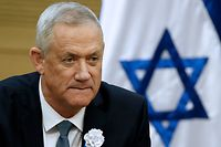 "(FILES) In this file photo taken on October 02, 2019, member of Knesset (MK) Benny Gantz of the Israel Resilience party that is part of the Kahol Lavan (Blue and White) electoral alliance attends a meeting of the alliance members at the Knesset in Jerusalem. - Israeli Prime Minister Benjamin Netanyahu informed the country's president on October 21, 2019 he could not form a new government following deadlocked September elections, making way for his opponent Benny Gantz to try. ""A short time ago I informed the president that I was handing back my mandate to try to form a government,"" Netanyahu said in a video posted on his official Facebook page. (Photo by EMMANUEL DUNAND / AFP)"