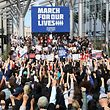 LAS VEGAS, NV - MARCH 24: People raise their fists as organizer Denise Hooks (C) speaks during the March for Our Lives rally at Las Vegas City Hall on March 24, 2018 in Las Vegas, Nevada. More than 800 March for Our Lives events, organized by survivors of the Parkland, Florida school shooting on February 14 that left 17 dead, are taking place around the world to call for legislative action to address school safety and gun violence.   Ethan Miller/Getty Images/AFP == FOR NEWSPAPERS, INTERNET, TELCOS & TELEVISION USE ONLY ==