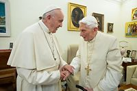"""(FILES) This file handout picture taken and released by Vatican Media on December 21, 2018, shows Pope Francis (L) meeting with Pope Benedict XVI (R) at the Vatican. - Former pope Benedict XVI has publicly urged his successor Pope Francis not to open the Catholic priesthood up to married men, in a plea that stunned Vatican experts on January 12, 2020. (Photo by Handout / VATICAN MEDIA / AFP) / RESTRICTED TO EDITORIAL USE - MANDATORY CREDIT """"AFP PHOTO / VATICAN MEDIA"""" - NO MARKETING NO ADVERTISING CAMPAIGNS - DISTRIBUTED AS A SERVICE TO CLIENTS ---"""