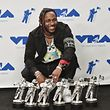 INGLEWOOD, CA - AUGUST 27: Kendrick Lamar, winner of Video of the Year, Best Hip Hop, Best Cinematography, Best Direction, Best Art Direction, Best Visual Effects for 'Humble', poses in the press room during the 2017 MTV Video Music Awards at The Forum on August 27, 2017 in Inglewood, California.   Alberto E. Rodriguez/Getty Images/AFP == FOR NEWSPAPERS, INTERNET, TELCOS & TELEVISION USE ONLY ==