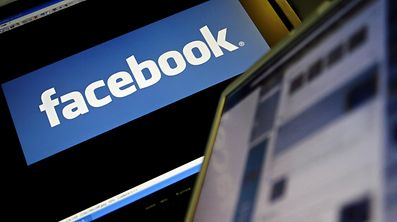 "(FILES) This file photo taken on December 12, 2007 shows the logo of social networking website 'Facebook' displayed on a computer screen in London. Facebook said on June 27, 2017 its ranks of monthly active users had hit the two billion mark -- meaning more than a quarter of the world's population is on the giant social network. ""There are now two billion people connecting and building communities on Facebook every month,"" vice president of social good Naomi Gleit said in an online post.  / AFP PHOTO / LEON NEAL"
