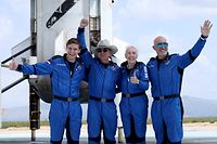 VAN HORN, TEXAS - JULY 20: Blue Origin�s New Shepard crew (L-R) Oliver Daemen, Jeff Bezos, Wally Funk, and Mark Bezos pose for a picture near the booster after flying into space in the Blue Origin New Shepard rocket on July 20, 2021 in Van Horn, Texas. Mr. Bezos and the crew were the first human spaceflight for the company.   Joe Raedle/Getty Images/AFP == FOR NEWSPAPERS, INTERNET, TELCOS & TELEVISION USE ONLY ==