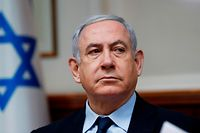(FILES) A file photo taken on February 9, 2020 shows Israeli Prime Minister Benjamin Netanyahu chairing the weekly cabinet meeting in Jerusalem. - A new page in Israeli history opens Sunday as Prime Minister Benjamin Netanyahu becomes the first sitting premier to face criminal charges, accused of a string of corruption allegations he denies. After more than 500 days of electoral deadlock in which he fought for his political survival Netanyahu is to take his seat in the Jerusalem District Court for a new battle -- to stay out of prison and avoid a stain on his legacy. (Photo by RONEN ZVULUN / POOL / AFP)