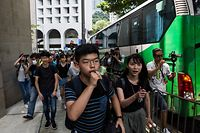 Pro-democracy activist Joshua Wong (C) marches towards the Central Government Office during a rally against a controversial extradition bill in Hong Kong on June 27, 2019. (Photo by ISAAC LAWRENCE / AFP)