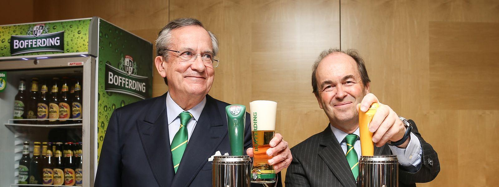 """Prost! Georges Lentz, Administrateur délégué der """"Brasserie Nationale"""" (l.), führt seit vielen Jahren das Familienunternehmen mit Generaldirektor Frédéric de Radiguès."""