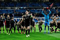 TOPSHOT - Ajax's players celebrate at the end of the UEFA Champions League round of 16 second leg football match between Real Madrid CF and Ajax at the Santiago Bernabeu stadium in Madrid on March 5, 2019. (Photo by GABRIEL BOUYS / AFP)