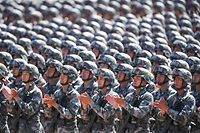 (FILES) This file photo taken on July 30, 2017 shows Chinese soldiers applauding during a military parade at the Zhurihe training base in China's northern Inner Mongolia region. - China will increase its military budget by 6.6 percent in 2020, the government announced on May 22, 2020 at the opening session of its annual National People's Congress in Beijing. (Photo by STR / AFP) / China OUT