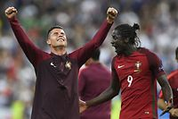 Portugal's forward Eder (R) and Portugal's forward Cristiano Ronaldo react after Portugal beat their hosts France 1-0 in the Euro 2016 final football match between France and Portugal at the Stade de France in Saint-Denis, north of Paris, on July 10, 2016. / AFP PHOTO / MARTIN BUREAU