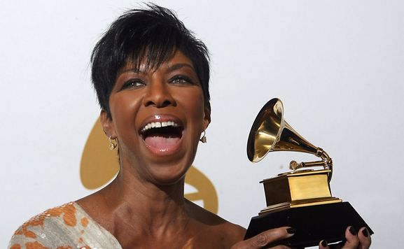 "2009 file photo of singer Natalie Cole with the Grammy award for the Best Traditional Pop Vocal Album for ""Still Unforgettable"""