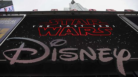 NEW YORK, NY - DECEMBER 14: The Disney logo is displayed outside the Disney Store in Times Square, December 14, 2017 in New York City. The Walt Disney Company announced on Thursday morning that it had reached a deal to purchase most of the assets of 21st Century Fox. The deal has a total value of around $66 billion, with Disney assuming $13.7 billion of Fox's net debt.   Drew Angerer/Getty Images/AFP == FOR NEWSPAPERS, INTERNET, TELCOS & TELEVISION USE ONLY ==