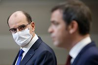 French Prime Minister Jean Castex (L) and  French Health Minister Olivier Veran address a press conference in Paris on January 14, 2021, on the current French government strategy for the ongoing coronavirus (Covid-19) epidemic. (Photo by Thomas COEX / various sources / AFP)