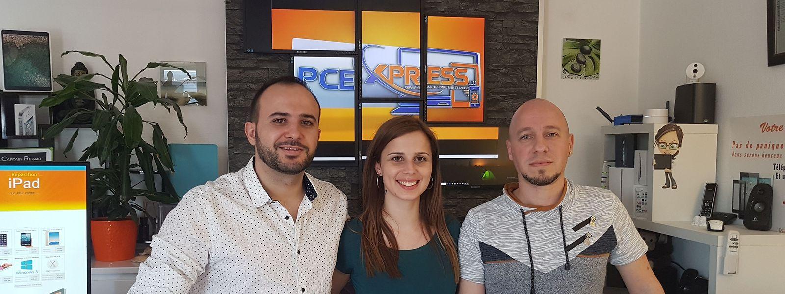 Esq para dta_Marco (gerente e técnico de informática), Cátia (administrativa e atendimento ao cliente) e Filipe (técnico de telemóveis)
