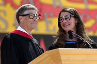 (FILES) In this file photo taken on June 14, 2014 Microsoft founder and chairman Bill Gates shares the stage with his wife Melinda during the 123rd Stanford commencement ceremony in Stanford, California. - Bill Gates, the Microsoft founder-turned philanthropist, and his wife Melinda are divorcing after a 27-year-marriage, the couple said in a joint statement Monday. The announcement from one of the world's wealthiest couples, with an estimated net worth of some $130 billion, was made on Twitter. (Photo by JUSTIN SULLIVAN / GETTY IMAGES NORTH AMERICA / AFP)