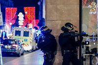 French police officers stand guard near the scene of a shooting on December 11, 2018 in Strasbourg, eastern France. - A gunman killed at least two people and seriously injured another 11 near the famed Christmas market in the French city of Strasbourg before fleeing the scene, security officials said. Police launched a manhunt after the killer opened fire at around 7pm local time (1800 GMT), sending crowds of evening shoppers fleeing for safety. (Photo by Abdesslam MIRDASS / AFP)