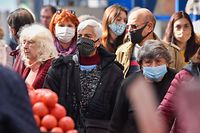 People wear face masks as they shop groceries in Sofia's largest outdoor groceries market in Sofia, on October 23, 2020. - Bulgaria made mask-wearing mandatory in busy outdoor spaces on Thursday and called on medical students to help shore up its fragile healthcare system against a burgeoning second coronavirus wave. (Photo by NIKOLAY DOYCHINOV / AFP)