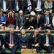 "TOPSHOT - A handout photograph released by the UK Parliament on March 14, 2019 shows Britain's Prime Minister Theresa May (C) reacting on the front bench in the House of Commons in London on March 14, 2019, during the proceedings in which British MPs voted to ask the European Union to delay Brexit, with just two weeks to go until the UK is scheduled to leave the bloc. - British MPs have voted to ask the European Union to delay Brexit, with just two weeks to go until the UK is scheduled to leave the bloc. (Photo by JESSICA TAYLOR / UK PARLIAMENT / AFP) / RESTRICTED TO EDITORIAL USE - NO USE FOR ENTERTAINMENT, SATIRICAL, ADVERTISING PURPOSES - MANDATORY CREDIT "" AFP PHOTO / JESSICA TAYLOR / UK Parliament"""