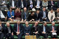 """TOPSHOT - A handout photograph released by the UK Parliament on March 14, 2019 shows Britain's Prime Minister Theresa May (C) reacting on the front bench in the House of Commons in London on March 14, 2019, during the proceedings in which British MPs voted to ask the European Union to delay Brexit, with just two weeks to go until the UK is scheduled to leave the bloc. - British MPs have voted to ask the European Union to delay Brexit, with just two weeks to go until the UK is scheduled to leave the bloc. (Photo by JESSICA TAYLOR / UK PARLIAMENT / AFP) / RESTRICTED TO EDITORIAL USE - NO USE FOR ENTERTAINMENT, SATIRICAL, ADVERTISING PURPOSES - MANDATORY CREDIT """" AFP PHOTO / JESSICA TAYLOR / UK Parliament"""""""