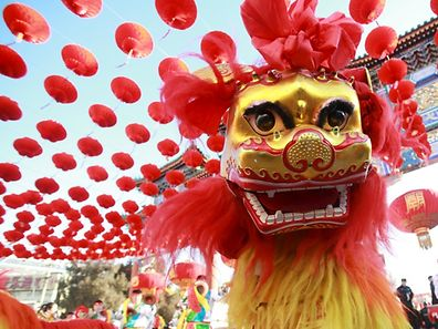 Traditional dancers perform the lion dance during the opening ceremony of a temple fair in Ditan Park at the beginning of Chinese Lunar New Year in Beijing, China, February 8, 2016. REUTERS/Stringer ATTENTION EDITORS - THIS PICTURE WAS PROVIDED BY A THIRD PARTY. THIS PICTURE IS DISTRIBUTED EXACTLY AS RECEIVED BY REUTERS, AS A SERVICE TO CLIENTS. CHINA OUT. NO COMMERCIAL OR EDITORIAL SALES IN CHINA.