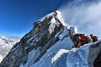 """(FILES) In this file handout photo taken on May 22, 2019 and released by climber Nirmal Purja's Project Possible expedition shows heavy traffic of mountain climbers lining up to stand at the summit of Mount Everest. - Three more climbers have died on Everest, expedition organisers and officials said on May 24, taking the toll from a deadly week on the overcrowded world's highest peak to seven. (Photo by Handout / Project Possible / AFP) / RESTRICTED TO EDITORIAL USE - MANDATORY CREDIT """"AFP PHOTO / PROJECT POSSIBLE"""" - NO MARKETING NO ADVERTISING CAMPAIGNS - DISTRIBUTED AS A SERVICE TO CLIENTS ---"""