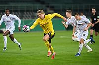 Dortmund's Norwegian forward Erling Braut Haaland runs for the ball during the German Cup (DFB Pokal) quarter-final football match between Borussia Moenchengladbach and Borussia Dortmund in Moenchengladbach, western Germany, on March 2, 2021. (Photo by Ina Fassbender / various sources / AFP) / DFB REGULATIONS PROHIBIT ANY USE OF PHOTOGRAPHS AS IMAGE SEQUENCES AND QUASI-VIDEO.