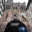 A French gendarme patrols in front of the Strasbourg cathedral while searches are conducted on December 12, 2018 for the gunman who opened fire near a Christmas market in Strasbourg, eastern France, the night before. - Hundreds of security forces were deployed in the hunt for a lone gunman who killed at least three people and wounded a dozen others at the famed Christmas market in Strasbourg, with the French government raising the security alert level and reinforcing border controls. (Photo by SEBASTIEN BOZON / AFP)