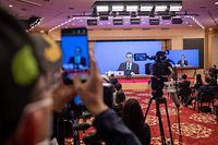 China's Foreign Minister Wang Yi speaks during his online video link press conference during the National People's Congress (NPC) at the media centre in Beijing on May 24, 2020. (Photo by NICOLAS ASFOURI / AFP)