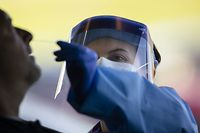 SPRINGFIELD, TN - APRIL 18: Detail view of a medical professional administering a test for coronavirus (covid-19) at a drive thru test site on April 18, 2020 in Springfield, Tennessee. Tennessee drive thru testing sites now allow those without symptoms of coronavirus (covid-19) to receive testing.   Brett Carlsen/Getty Images/AFP == FOR NEWSPAPERS, INTERNET, TELCOS & TELEVISION USE ONLY ==