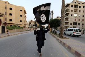 """A member loyal to the Islamic State in Iraq and the Levant (ISIL) waves an ISIL flag in Raqqa June 29, 2014. The offshoot of al Qaeda which has captured swathes of territory in Iraq and Syria has declared itself an Islamic """"Caliphate"""" and called on factions worldwide to pledge their allegiance, a statement posted on jihadist websites said on Sunday. The group, previously known as the Islamic State in Iraq and the Levant (ISIL), also known as ISIS, has renamed itself """"Islamic State"""" and proclaimed its leader Abu Bakr al-Baghadi as """"Caliph"""" - the head of the state, the statement said. REUTERS/Stringer (SYRIA - Tags: POLITICS CIVIL UNREST)"""
