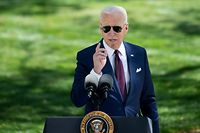 TOPSHOT - US President Joe Biden speaks about updated CDC guidance on masks for people who are fully vaccinated during an event in front of the White House April 27, 2021, in Washington, DC. (Photo by Brendan Smialowski / AFP)