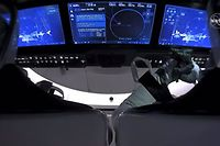 "This NASA video frame grab image shows SpaceX�s Crew Dragon spacecraft with NASA astronauts Douglas Hurley and Robert Behnken watching on their screens an infrared view of the International Space Station after undocking from it on August 1, 2020. - The SpaceX Crew Dragon spacecraft undocked from the International Space Station on August 1, beginning its journey back to Earth with two US astronauts on board, NASA footage showed. ""Separation confirmed. Dragon performing 4 departure burns to move away from the @Space_Station,"" SpaceX tweeted following the capsule's apparently smooth and on-time separation. (Photo by Handout / NASA TV / AFP) / RESTRICTED TO EDITORIAL USE - MANDATORY CREDIT ""AFP PHOTO /NASA TV/HANDOUT "" - NO MARKETING - NO ADVERTISING CAMPAIGNS - DISTRIBUTED AS A SERVICE TO CLIENTS"