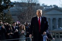US President Donald Trump walks by supporters outside the White House on January 12, 2021 in Washington,DC before his departure to Alamo, Texas. (Photo by Brendan Smialowski / AFP)