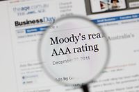 """(FILES) A closeup taken on December 23, 2011 in Paris, shows a media website with triple """"A"""" letters ( AAA ). Moody's downgraded France sovereign debt from its triple A rating to 'Aa1' on November 19, 2012. AFP PHOTO / THOMAS COEX"""